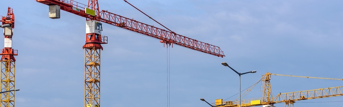 Cranes Supporting Construction Booms